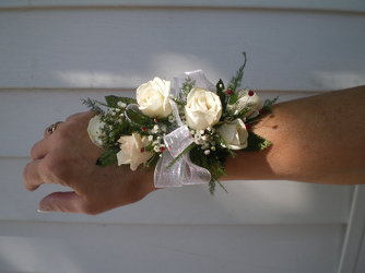 white spray rose wristlet your flower shop in Wyckoff, NJ